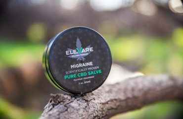 migraine topical rub sitting on branch